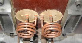 <b> Ohřev součástí</b>:  Vhodně tvarovaný induktor pro ohřev části výrobku.